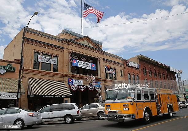 Glendale Fire Department truck drives through downtown Prescott en route to the Yarnell fire on July 2 2013 in Prescott Arizona Nineteen Granite...