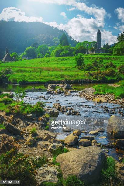 glendalough monastic site in country wicklow, ireland - irish round tower stock photos and pictures