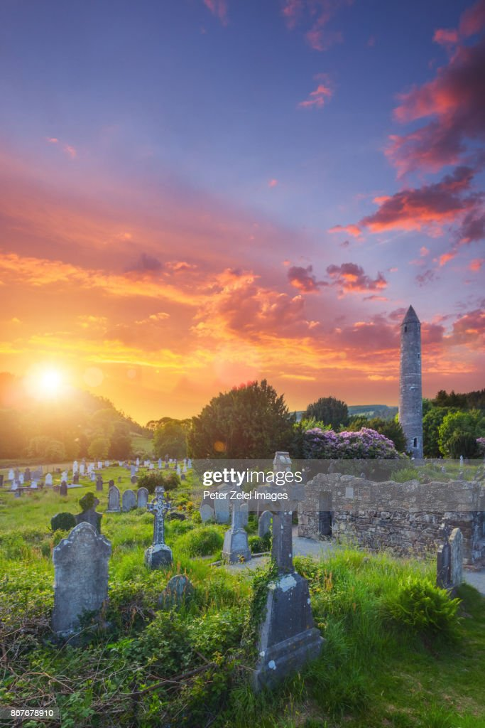 Glendalough monastic site with the round tower and cemetery in County Wicklow, Ireland : Stock Photo