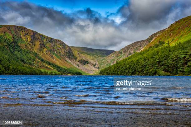glendalough upper lake - ring of kerry stock photos and pictures
