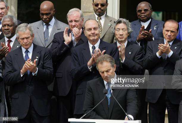 Gleneagles, United Kingdom: British Prime Minister Tony Blair gives a statement as leaders of the Group of Eight and African leaders stand behind him...