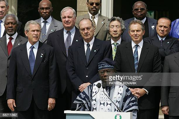 President Olusegun Obasanjo of Nigeria gives a statement as leaders of the Group of Eight and African leaders stand behind him at the end of a G8...