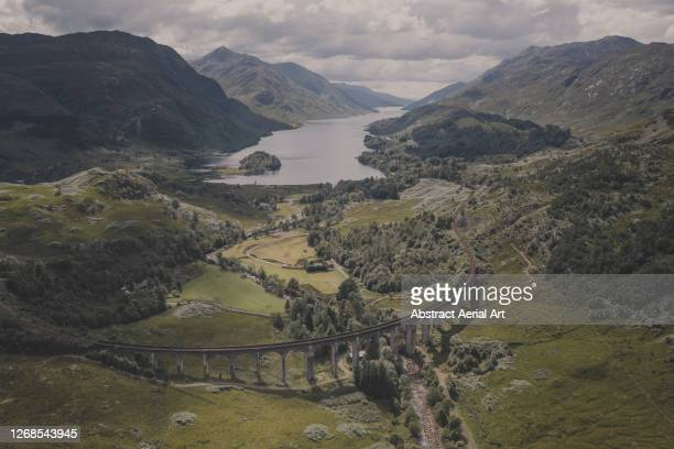 glenfinnan viaduct photographed from an aerial point of view, scotland, united kingdom - drone point of view stock pictures, royalty-free photos & images