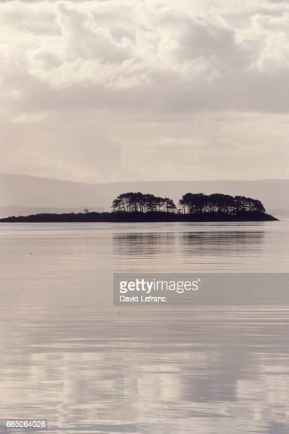 Glengarriff Bay located between Kenmare and Bantry in County Kerry with the Caha mountains in the background Images and captions taken from the book...