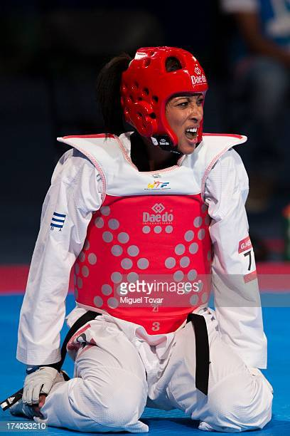 Glenhis Hernandez of Cuba reacts after a point against Guinafis Altmukham of Kazajst‡n during the women's 73 kg combat of WTF World Taekwondo...