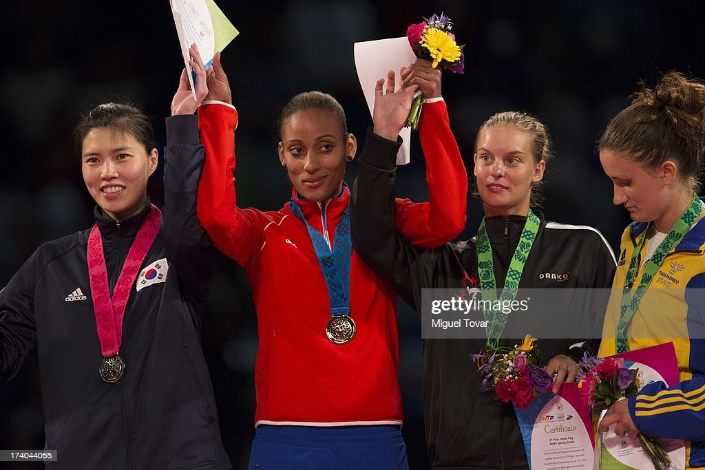 Glenhis Hernandez of Cuba receives the gold medal during the women's -73 kg final combat of WTF World Taekwondo Championships 2013 at the exhibitions Center on July 19, 2013 in Puebla, Mexico.