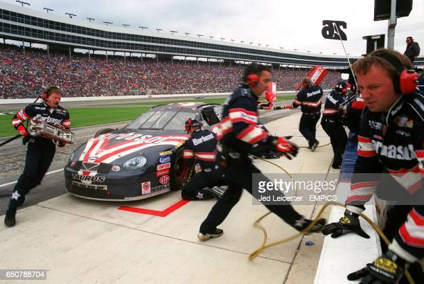 Glenn Allen Jr's pit crew finish off the work on his Barbasol Chevrolet during a pit stop
