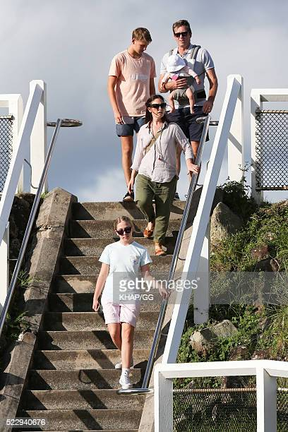 Glenn and Sara McGrath pictured enjoying a beach outing with their family on April 18 2016 in Byron Bay Australia