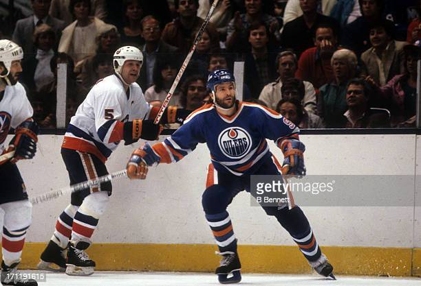 Glenn Anderson of the Edmonton Oilers defends against Denis Potvin of the New York Islanders during the 1984 Stanley Cup Finals in May 1984 at the...