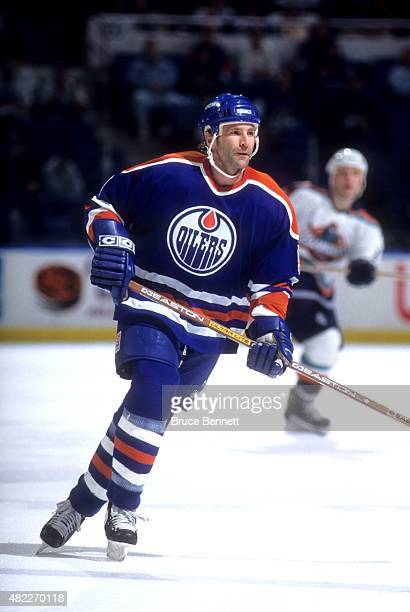 Glenn Anderson of the Edmonton Oilers skates on the ice during an NHL game against the New York Islanders on February 25, 1996 at the Nassau Coliseum...