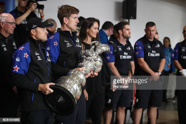 Glenn Ashby and Peter Burling of Team New Zealand arrive at Auckland International Airport with the America's Cup on July 5 2017 in Auckland New...