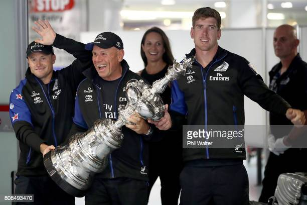 Glenn Ashby Grant Dalton and Peter Burling of Team New Zealand arrive at Auckland International Airport with the Americas Cup Trophy on July 5 2017...