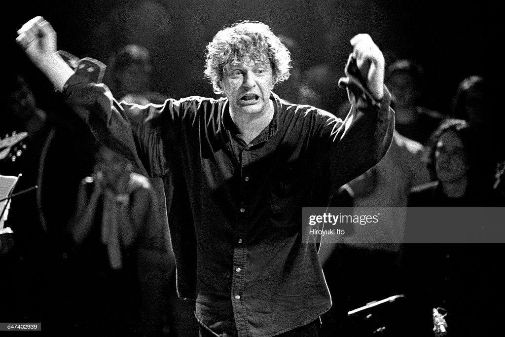 Glenn Branca conducting his ensemble at the Anchorage in Brooklyn on Thursday night, July 20, 2000.