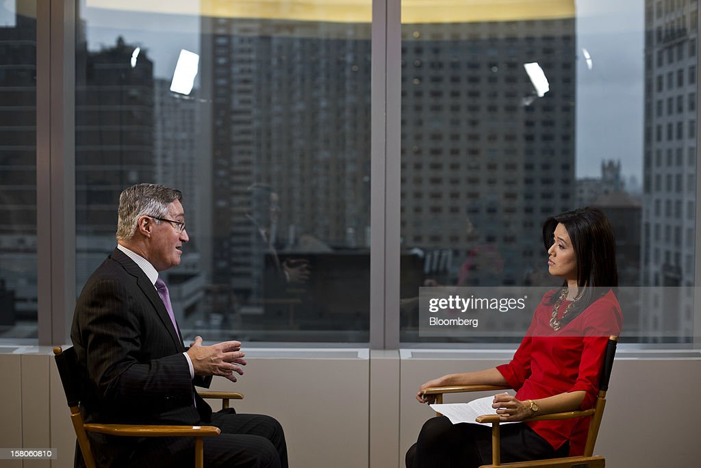Glenn Britt, chairman and chief executive officer of Time Warner Cable Inc., left, speaks during a Bloomberg Television interview on Friday, Dec. 7, 2012. AMC Networks Inc.'s IFC and WE TV are among the networks at risk of being dropped by Time Warner Cable Inc. now that Britt is taking a harder line on renewing channels with low ratings. Photographer: Victor J. Blue/Bloomberg via Getty Images