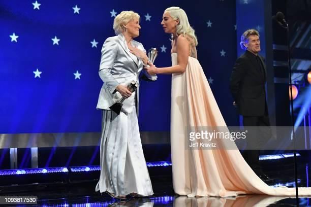 Glenn Close and Lady Gaga onstage at The 24th Annual Critics' Choice Awards at Barker Hangar on January 13 2019 in Santa Monica California