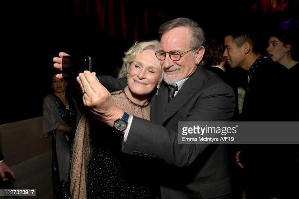Glenn Close and Steven Spielberg pose for a selfie during the 2019 Vanity Fair Oscar Party hosted by Radhika Jones at Wallis Annenberg Center for the...