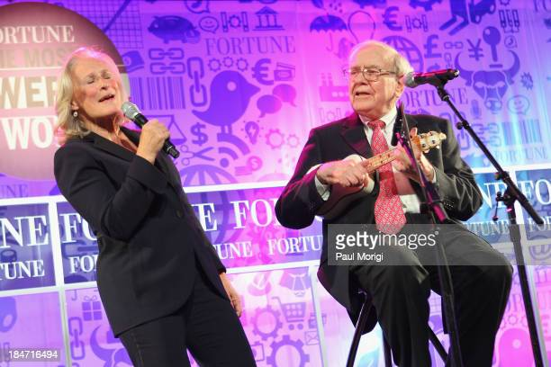 Glenn Close and Warren Buffett perform onstage at FORTUNE Most Powerful Women Summit on October 15 2013 in Washington DC