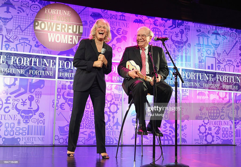 Glenn Close and Warren Buffett perform onstage at FORTUNE Most Powerful Women Summit on October 15, 2013 in Washington, DC.