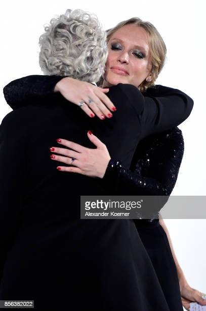 Glenn Close gets congratulated by her daughter Annie Maude Starke during the Golden Icon Award ceremony at the 'The Wife' premiere at the 13th Zurich...
