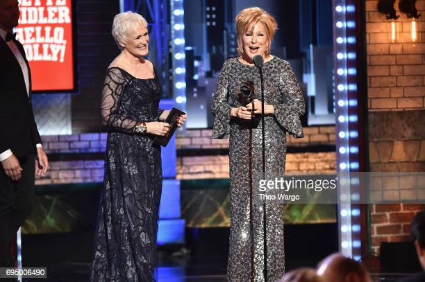 "Glenn Close presents Bette Midler with the award for Best Performance by an Actress in a Leading Role in a Musical for ""Hello Dolly"" onstage during..."