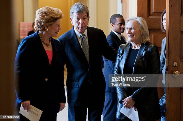 Glenn Close right actress and founder of Bring Change 2 Mind Sens Roy Blunt RMo and Debbie Stabenow DMich make their way to a news conference in the...