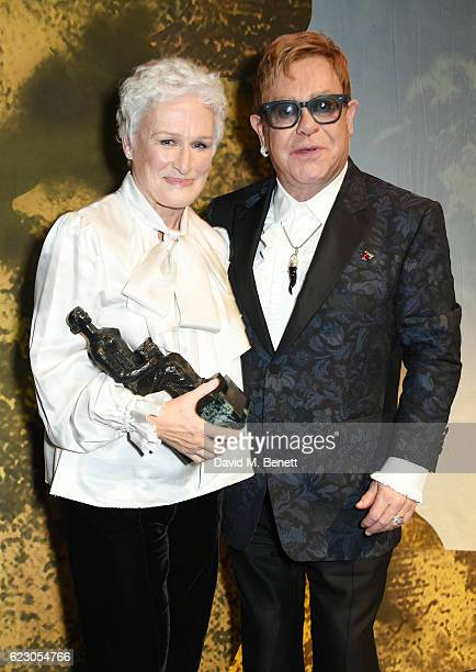 Glenn Close, winner of the Best Musical Performance award, and Sir Elton John pose onstage at the 62nd London Evening Standard Theatre Awards,...
