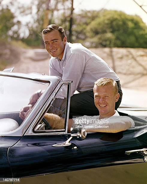Glenn Corbett US actor and Martin Milner US actor sitting in their Corvette convertible in a publicity portrait issued for the US television series...