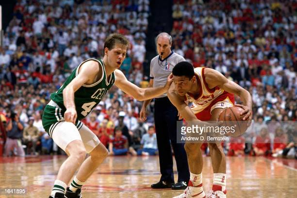 Glenn 'Doc' Rivers of the Atlanta Hawks looks to pass during the 1988 NBA game against Danny Ainge of the Boston Celtics at the Omni in Atlanta...