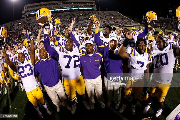 Glenn Dorsey and Coach Les Miles of the LSU Tigers lead their team in the LSU Alma Mater after a game against the Mississippi Rebels at...