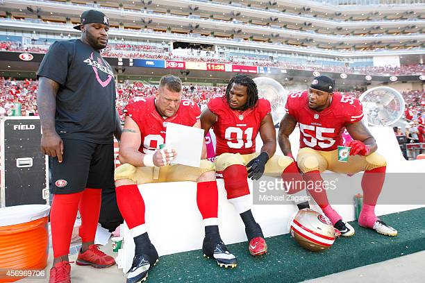 Glenn Dorsey of the San Francisco 49ers looks over chats with Justin Smith Ray McDonald and Ahmad Brooks during the game against the Kansas City...