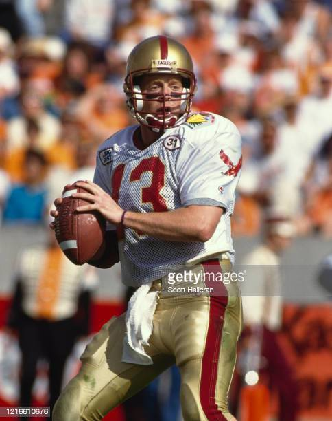 Glenn Foley#13, Quarterback for the Boston College Eagles runs the ball during the NCAA Hall of Fame Bowl college football game against the...