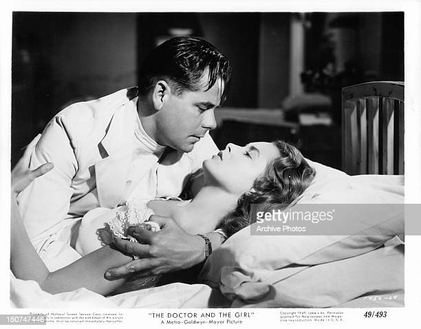 Glenn Ford holds Nancy Davis in his arms as he looks at her with passion in a scene from the film 'The Doctor And The Girl' 1949