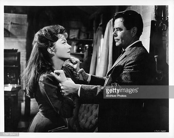 Glenn Ford holds the arms of Anne Baxter in a scene from the film 'Cimarron' 1960