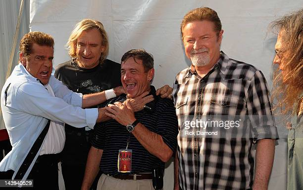 Glenn Frey Joe Walsh Don Henley and Timothy B Schmit of the Eagles with Tour Mananger Chris Littleton backstage during the 2012 New Orleans Jazz...