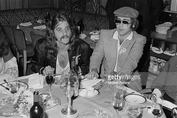 Glenn Frey of American rock group The Eagles with English singersongwriter Elton John at a party given by the American group 26th April 1977