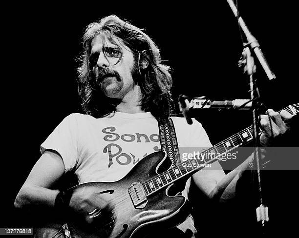 Glenn Frey of the Eagles performs on stage at Wembley Empire Pool London 26 April 1977 He plays a Gibson ES330 guitar