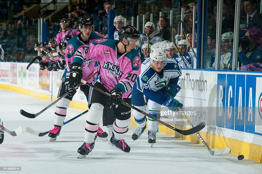 Glenn Gawdin #15 of Swift Current Broncos digs for the puck with Connor Bruggen-Cate #20 of Kelowna Rockets on October 15, 2016 at Prospera Place in Kelowna, British Columbia, Canada.