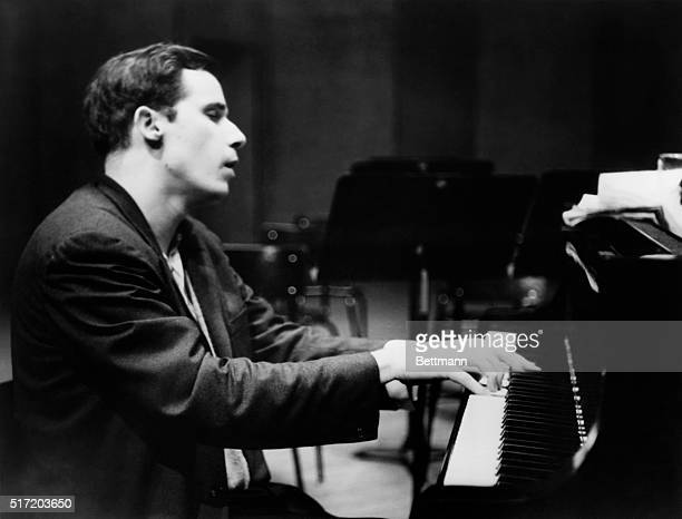 Glenn Gould seated at the piano.