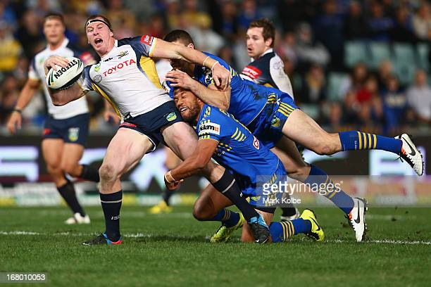 Glenn Hall of the Cowboys is tackled during the round eight NRL match between the Parramatta Eels and the North Queensland Cowboys at Parramatta...