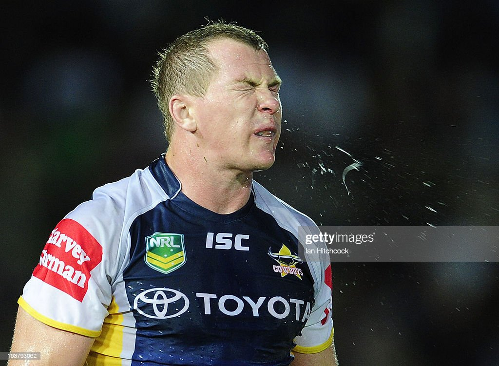 Glenn Hall of the Cowboys spits during the round two NRL match between the North Queensland Cowboys and the Melbourne Storm at 1300SMILES Stadium on March 16, 2013 in Townsville, Australia.