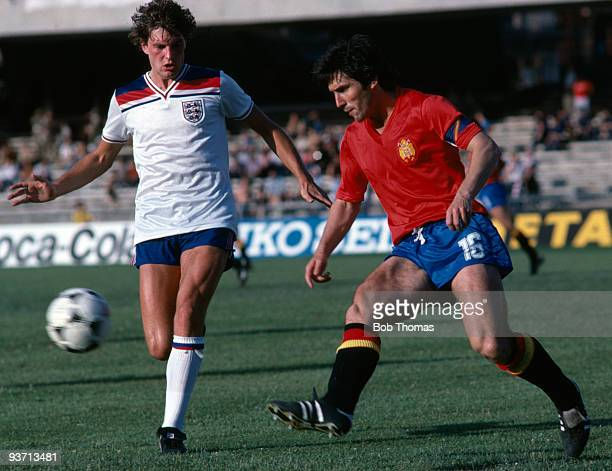 Glenn Hoddle of England with Carlos Santillana of Spain during the England v Spain European Championship finals held at Stadio San Paolo in Naples...