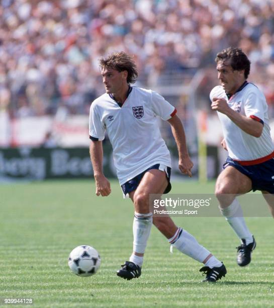 Glenn Hoddle of England with Kenny Sansom in support during an International match circa 1988