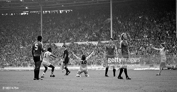 Glenn Hoddle of Tottenham Hotspur falls to his knees after scoring as Garth Crooks runs to congratulate him during the FA Cup Final between Queens...