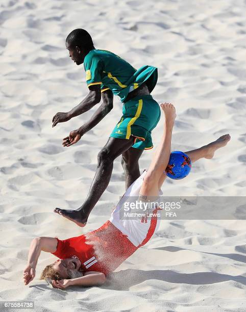 Glenn Hodel of Switzerland and Papa Ndour of Senegal challenge for the ball during the FIFA Beach Soccer World Cup Bahamas 2017 group A match between...
