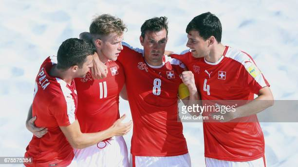 Glenn Hodel of Switzerland celebrates a goal with team mates Sandro Spaccarotella Mo Jaeggy and Nicola Werder during the FIFA Beach Soccer World Cup...