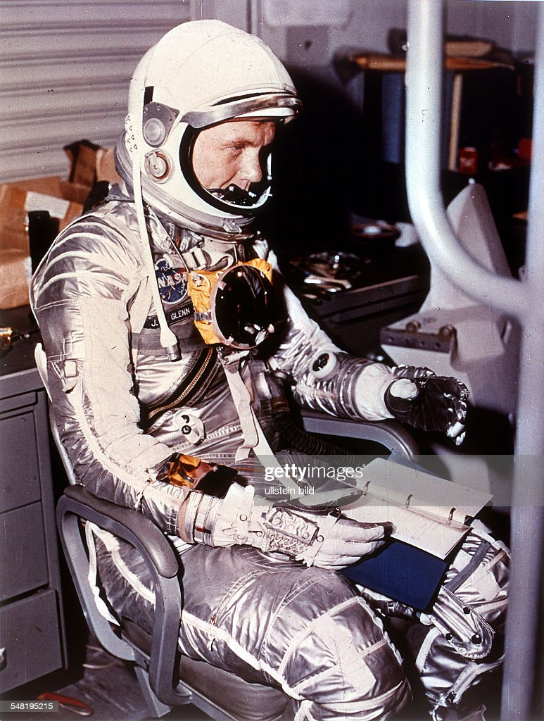 an astronaut in his space suit and with a propulsion -#main