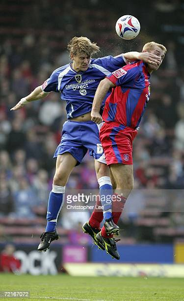 Glenn Loovens of Cardiff City jumps for the ball with James Scrowcroft of Crystal Palace during the CocaCola Championship match between Crystal...