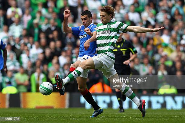 Glenn Loovens of Celtic stretches for the ball with Salim Kerkar of Rangers during the Clydesdale Bank Premier League match between Celtic and...