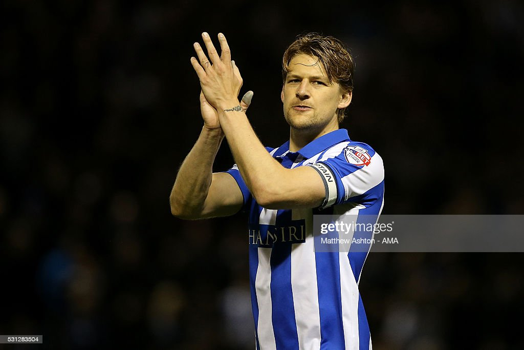 Glenn Loovens of Sheffield Wednesday acknowledges the fans at the end of the Sky Bet Championship Play Off First Leg match between Sheffield Wednesday and Brighton & Hove Albion at Hillsborough stadium on May 13, 2016 in Sheffield, England.