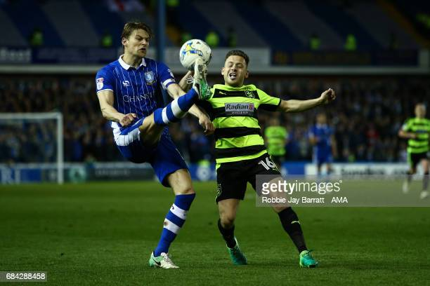 Glenn Loovens of Sheffield Wednesday and Jack Payne of Huddersfield Town during the Sky Bet Championship match between Sheffield Wednesday and...
